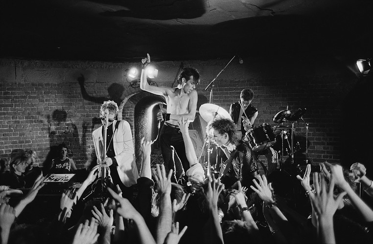 LONDON - 1st AUGUST: Bauhaus perform live on stage at the Roundhouse in Camden, London during the filming of their video to 'Ziggy Stardust' in August 1982. Left to Right: David J, Peter Murphy, Daniel Ash, Kevin Haskins. (Photo by Fin Costello/Redferns)