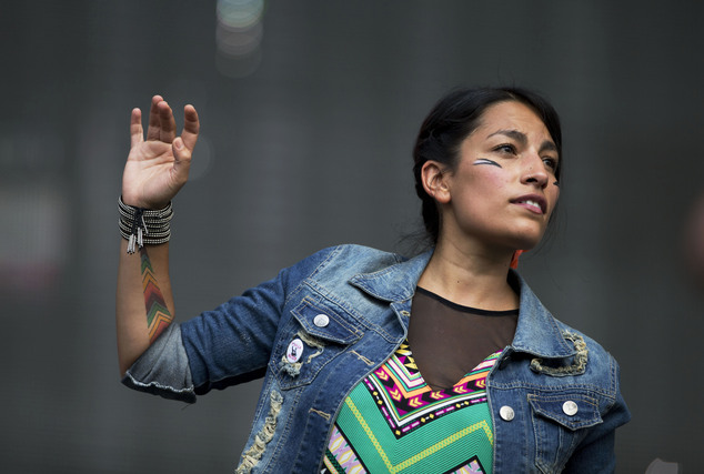 """FILE - In this March 28, 2014 file photo, Ana Tijoux performs at the15th edition of the Vive Latino music festival in Mexico City. Tijoux, whose rap song """"La Bala"""" (The Bullet) became the soundtrack for Chile's student movement by rallying crowds to protest without fear, has emerged as one of the most influential voices in Latin America's hip-hop scene. (AP Photo/Rebecca Blackwell, File)"""